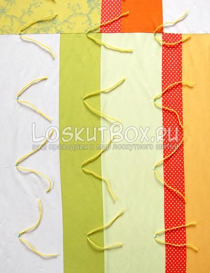 Обрезка стежков в конце одеяло из лоскутков