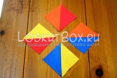 разноцветные детали из ткани квадраты на рабочем столе