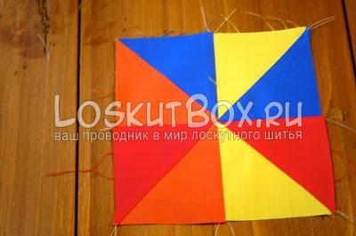 разноцветный квадрат из ткани на рабочем столе
