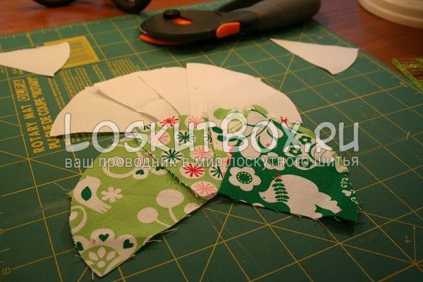 лоскуты ткани на рабочей поверхности дисковый нож